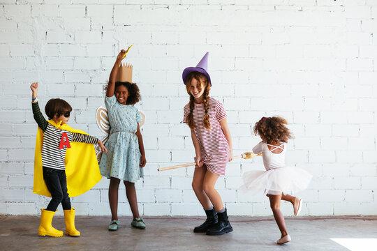 Happy diverse kids in Halloween costumes