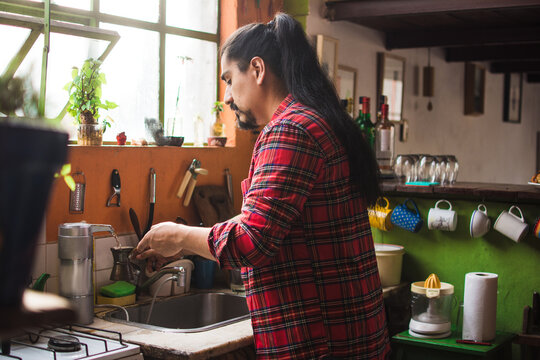 Long haired guy making coffee