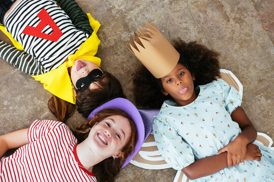Diverse kids in Halloween costumes making faces