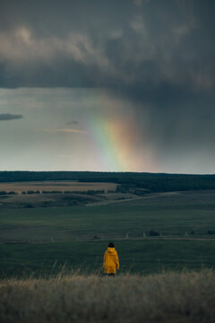 Unidentified woman watching rainbow rays in the sky
