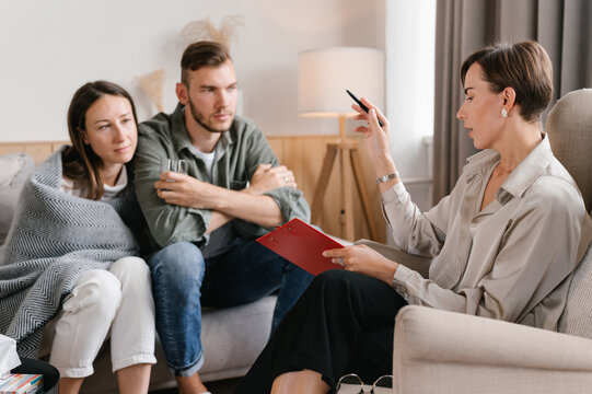 Female realtor and couple in new apartment