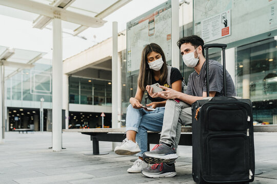 Couple at the airport wearing face masks
