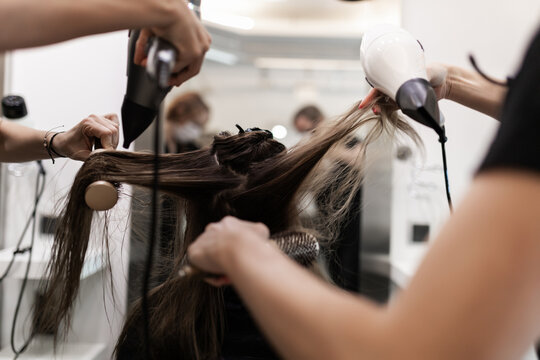 hairdressers combing a client