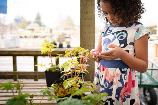 Girl examines bleeding heart plant