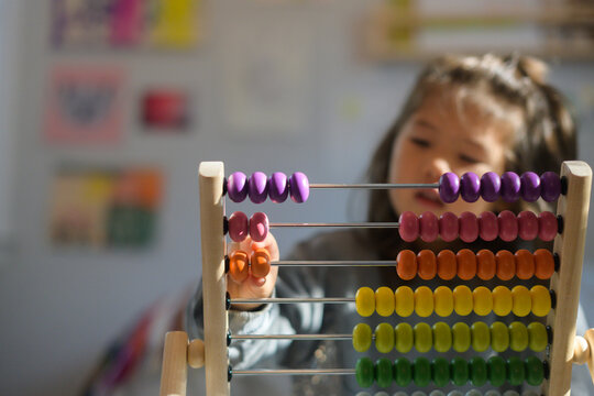 Child counting on abacus tool
