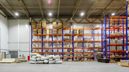 Interior of a modern warehouse storage of retail shop with pallet truck near shelves Wall mural