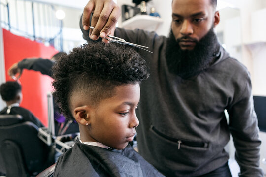 Barber: Stylist Uses Shears To Trim