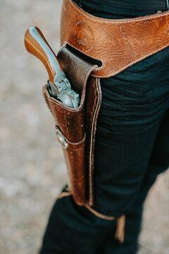 close up of a cowboy wearing gun