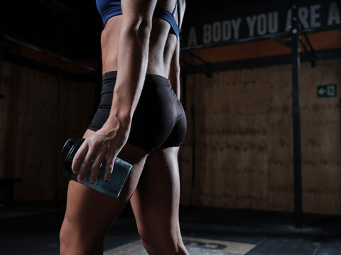 Fitness woman with gym water bottle