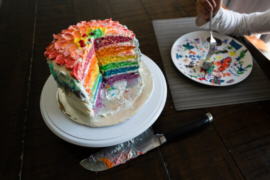 Child eating homemade frosted layer cake