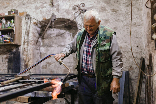 Old Blacksmith Works in his Workshop