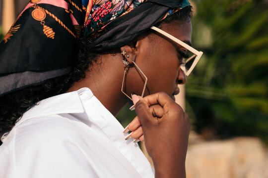 Black woman with cool earrings