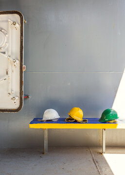 Workers helmets on a cargo ship