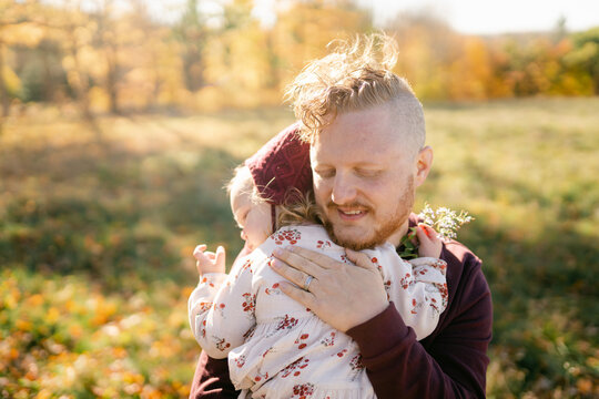 father holding his toddler girl