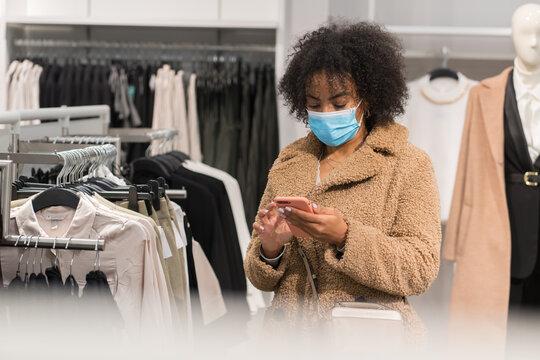 Costumer Wearing Medical Mask Using Cellphone
