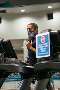 Gym: Focus On Man Running On Treadmill