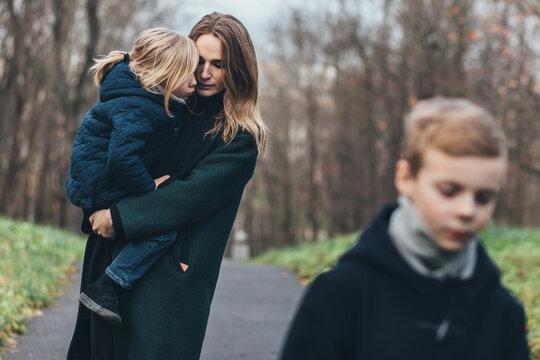 Women and children in autumn park