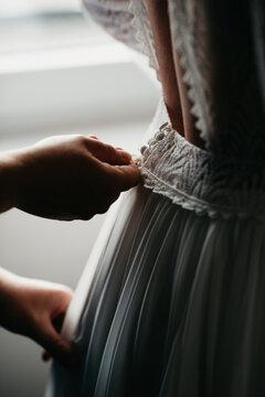 Zipping up wedding dress