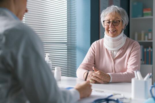 Doctor giving a prescription to a senior patient