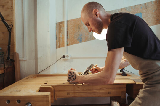 A violin artisan in his workshop.