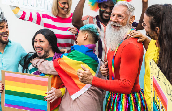 Happy Multiracial people celebrating gay pride event - Group of friends with different age and race having fun during LGBT event