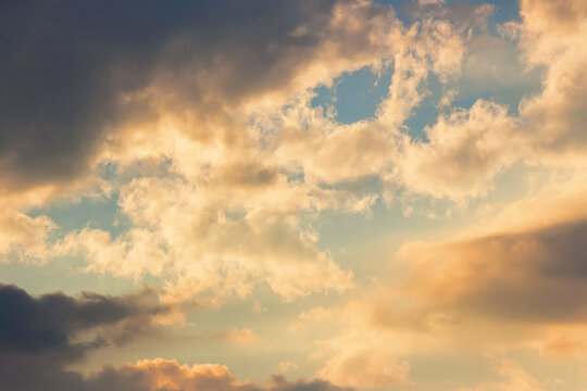 clouds in idyllic evening light. nature background in warm yellow and orange tones