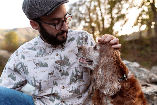Young alternative man looking with loyaty to his pet