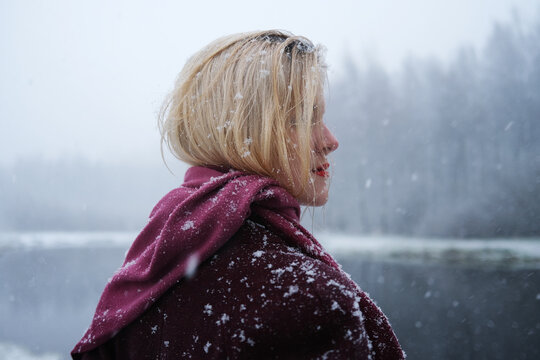 Young woman in blizzard