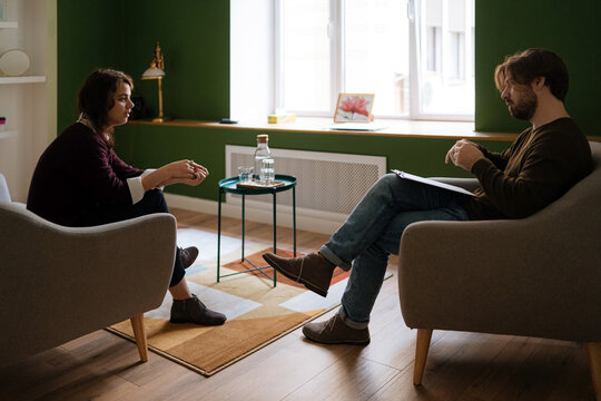 Man and woman during psychotherapy session