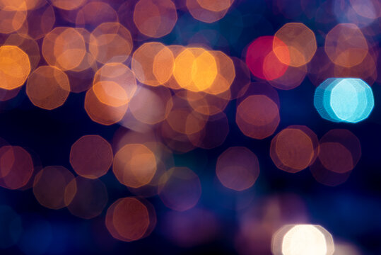 Blurred abstract lights with yellow and blue tones