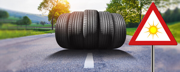 summer car tires on the street outside with traffic sign