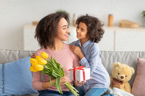 Black girl celebrating mother's day, greeting her mom