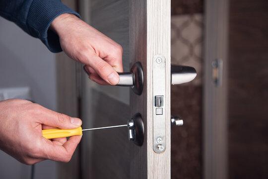 handyman repair the door lock