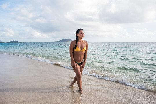 Woman in bikini, Lanikai Beach, Oahu, Hawaii