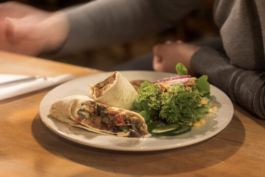 Plate of wrap sandwich ready on table
