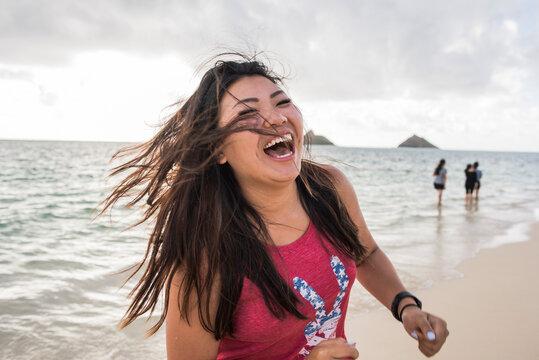 Woman swinging hair, Lanikai Beach, Oahu, Hawaii