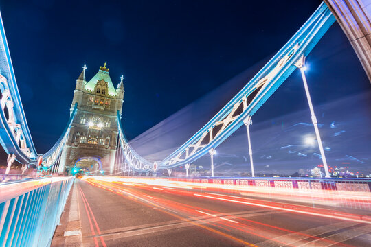Long exposure of Tower bridge at night with light stripes from traffic, City of London, UK