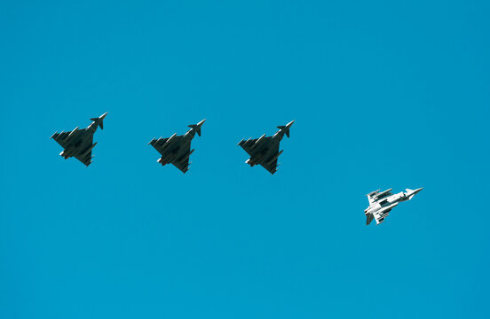 German Eurofighter Typhoon fighter planes taking part in NATO exercise Frysian flag, low angle against blue sky, Netherlands