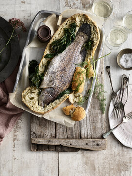 Whole fish baked in bread