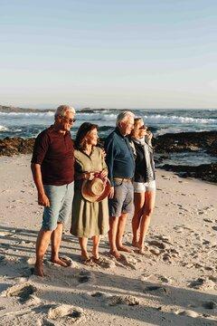 Senior couples enjoying sun on sandy beach
