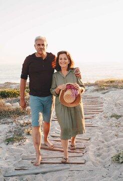 Senior couple taking walk on beach
