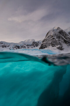 Over-under view of iceberg, Skontorp Cove, Paradise Bay, Antarctica