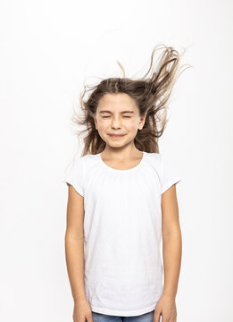 Girl with flying hair, white background