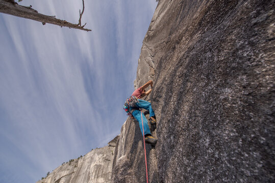 Rock climber scaling Heatwave, on top of The Chief, Squamish, Canada