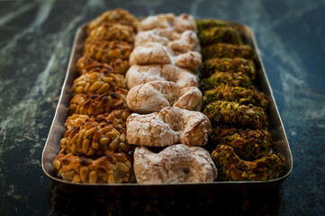 High angle close up of a tray with a selection of biscuits in the Pasticceria Savia Catania, Sicily, Italy.