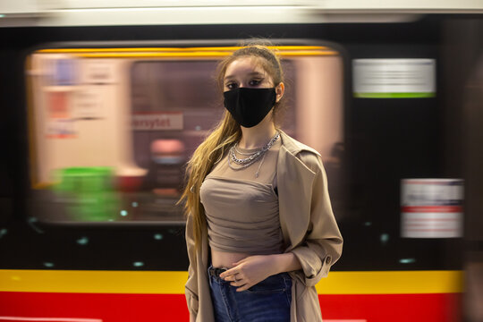 Woman in subway with protective mask