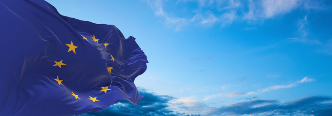 Obraz Large flag of The European Union  waving in the wind on flagpole against the sky with clouds on sunny day. 3d illustration - fototapety do salonu