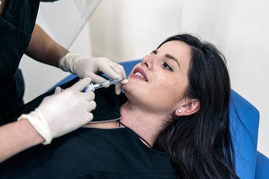 Woman Getting Lips Botox Treatment