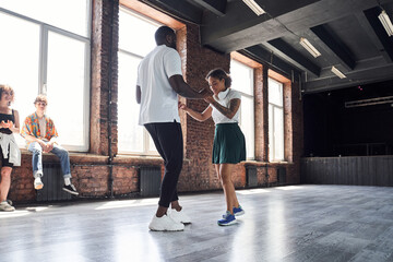 Afro American couple practicing modern dancing in studio
