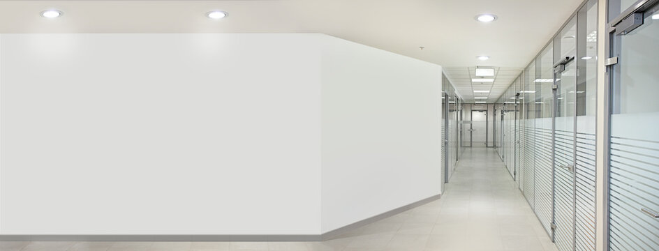 Empty bank office hall with glass walls and doors